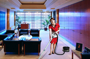 Woman hoovering in an office